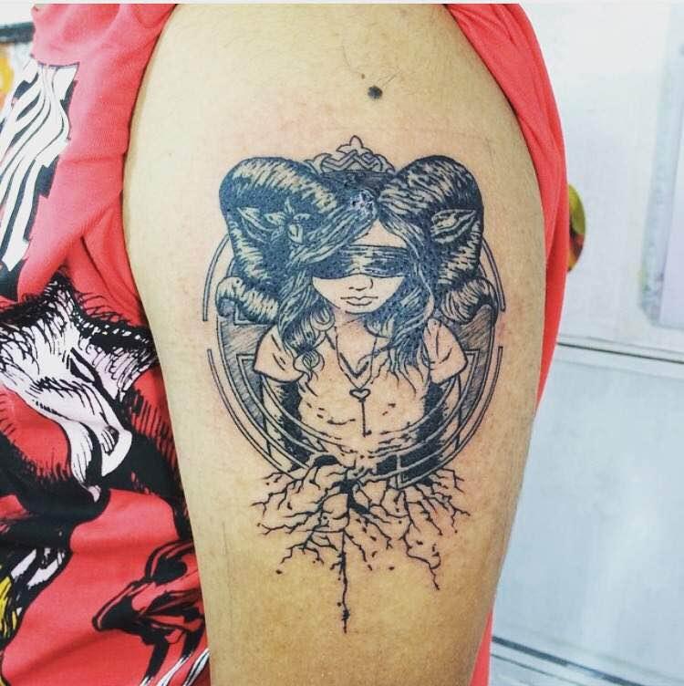Al's Tattoo n Body piercing Studio